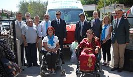 OSB Sakatlar Derneğine engelli aracı bağışladı